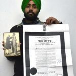 Satnam Singh, grandson of Hon Capt Karam Singh with photo of him receiving the PVC