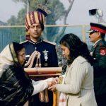 Col Jojan Thomas's wife, Mrs Beena receiving Ashok Chakra from President of India