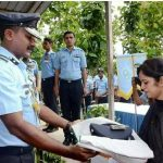 IAF officials handing over Sqn Ldr Pankaj's official belongings wrapped in the national Tricolour to his wife