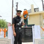 Lt Hitesh Kumat at his father's memorial of Lance Naik Bachan singh