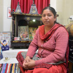 Mrs Bisht with photographs of her husband Hav Gajendra Singh in the family's puja room. She prays here every morning and evening.