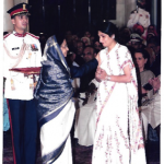 His wife receiving Kirti Chakra award from the President