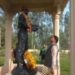 Brother of Capt Pawan Kumar paying tribute at his memorial