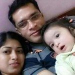 Lt Col Niranjan with his wife and daughter