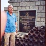 Captain Saurabh Kalia's father standing in front of his Memorial