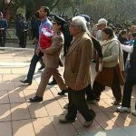 Maj Kumud Dogra wife of Wg Cdr D Vats going to the funeral of her husband carrying their 6 days old daughter