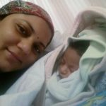 Maj Kumud Dogra wife of Wg Cdr D Vats with their few days old daughter on the fateful day
