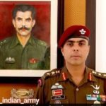 Col Varun Chhabra standing in front of the portrait of his father Lt Col Arun Kumar Chhabra