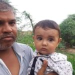 Sep Puspendra Singh's father holding his 7 month old son