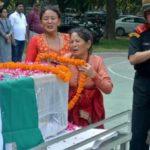 Homage being paid by the family members to Rfn Ram Babu Shahi