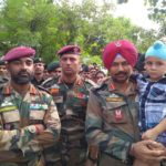 Son of Lance Naik Sandeep Singh with the CO of his battalion