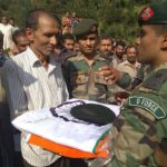 Father of Rifleman Shive Kumar receiving his belongings