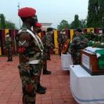 Army personnel pay their last respects to Lt Col Robert TA Kuba