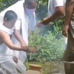 Son of Rfn Ratan Salam performing last rites