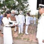 His wife receiving Tricolor