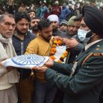 Army personnel with the family members of Naik Nishant Sharma