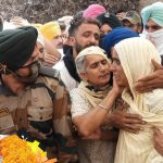 His mother Smt Melo Kaur paying her tribute