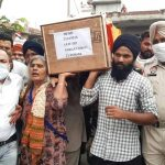 Mother during the last journey of her son Sep Pargat Singh