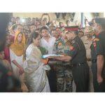 Major Prasad Mahadik's wife Gauri collecting the tri colour