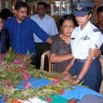 Grieving mother and wife of Flt Lt. Serrao pay their last respects