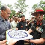 Army officers handover belongings wrapped in National flag to Major David Manlun's parents