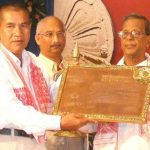 Captain Jintu Gogoi's father, Hon Fg Offr Thogiram receiving the state supreme bravery award