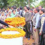 Flt Lt Neha Jaiswal lays a wreath on the pyre of her husband, Flt Lt Akash Yadav