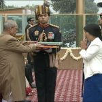 Hav Hangpan Dada's wife, Chasen Lowang receiving Ashoka Chakra from the President