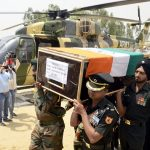 Indian Army personnel carry the coffin of Paramjit Singh
