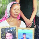 Jogyeswari Deuri with her son's photographs