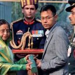 Major Laishram Jyotin Singh's brother receiving the award(AC) from the President