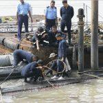 Navy personnel conducting salvage operation of INS Sindhurakshak
