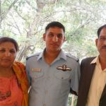 Flying Officer Pankaj with his parents Krishna Nandal and Usha Devi