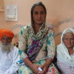 Paramjit Kaur, wife of Martyr Naib Subedar Paramjit Singh flanked by the martyr's parents.
