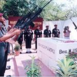 Paratroopers giving a salami shastra at the grave of Brig Mohammed Usman