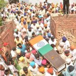 Relatives and residents carry the coffin of Nb Sub Paramjit Singh ahead of his funeral at Vein Poin village