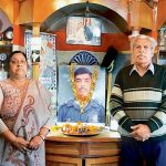 Saurabh Kalia's parents with a photo of their son. N.K. Kalia, the solider's father, expressed his disappointment at the Centre's stance