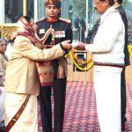 Shri K. Radhakrishnan receiving Ashoka Chakra Awarded to his son Capt. Harshan R (Posthumous) from the President, Smt. Pratibha Devisingh Patil, during the 59th Republic Day Parade-2008