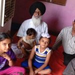 The father and children of Naik Bakhtawar Singh