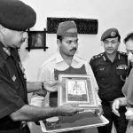 Mrs Anuradha Rajput, wife of the late Col. K.J. Singh of the Dogra Regiment, receiving the Badge of Sacrifice and Certificate of Honour