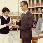 Capt Sharma receiving an award in his school