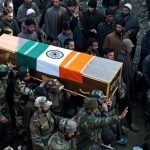 Army officers and jawans carrying the body of martyr L/NK Ghulam Mohi ud din Rather