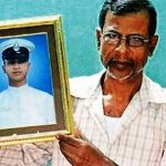 EMR II Malay Haldar's Father holding his picture