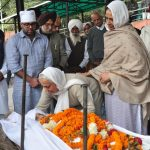 People pay their last respects to Brig Sant Singh